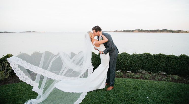 Wedding couple kiss on Cape Cod waterfront