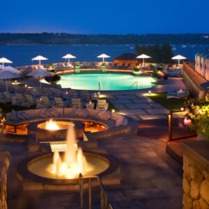 Fireplace and pool by the water