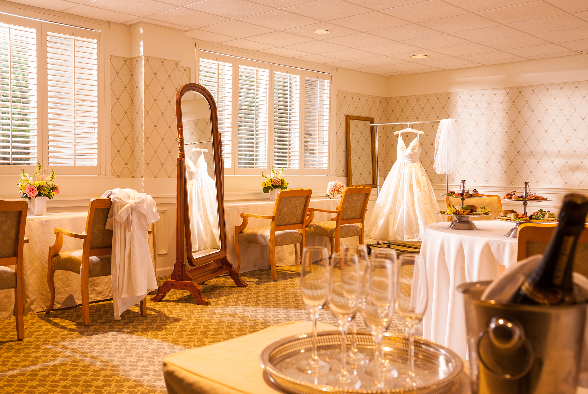 Wedding dress hanging in a room.