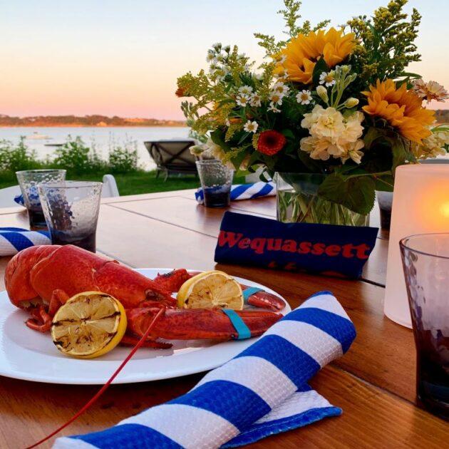 Wequassett resort lobster dinner on patio at sunset